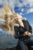 Young Woman Tossing Blond Hair — Stock Photo