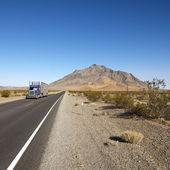 Truck on desert road. — Stock Photo