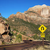 Winding road with sign. — Stock Photo