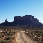 Dirt road and desert. — Stock Photo