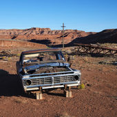 Junk car in desert. — Stock Photo