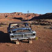 Junk car in desert. — Stock Photo