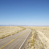 Road through barren landscape. — Stock Photo