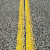 Double yellow lines in road. — Stock Photo