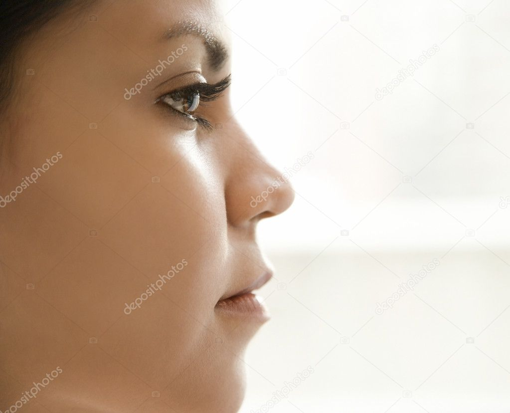 Close up profile of Hispanic young adult womans face. — Stock Photo #9502180