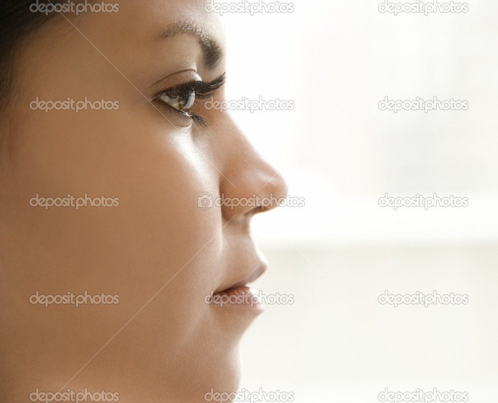 Close up profile of Hispanic young adult womans face.  Foto de Stock   #9502180