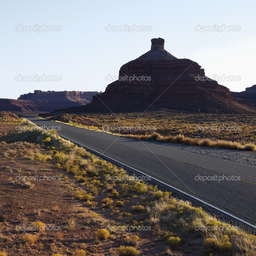 Two lane road travelling toward Garden of the Gods rock formation in Monument Valley, Utah. — Stock Photo #9509506