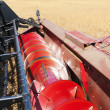 Combine harvesting soybeans. - Stock Photo