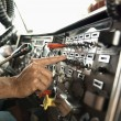 Interior of male hand pressing switch in tractor trailer. - Stok fotoğraf