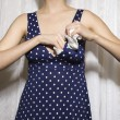 Woman stuffing bra. - Foto Stock