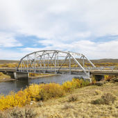 Bridge over stream in Wyoming. — Stock Photo