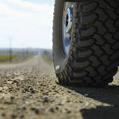 Truck tire on road. — Stock Photo