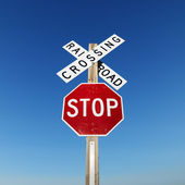 Railroad and stop sign. — Foto de Stock