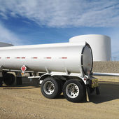 Fuel tanker and fuel farm. — Stock Photo