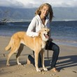 Stock Photo: Woman with dog.