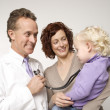 Physician amusing child. - Stock Photo