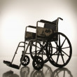Empty silhouetted wheelchair. — Stock Photo #9523356