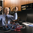 Businessman with computer cables. — Stock Photo