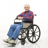 Elderly man in wheelchair. — Стоковое фото