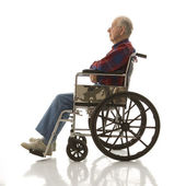 Elderly man in wheelchair. — Photo