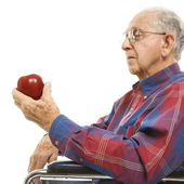 Elderly man holding apple. — Foto de Stock