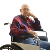 Elderly man in wheelchair. — Stockfoto