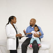 Father and baby with doctor. — Stock Photo