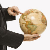 Businessman holding globe. — Stock Photo