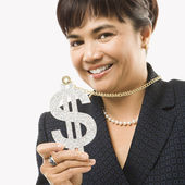 Woman wearing dollar sign. — Stock Photo