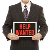 Man with help wanted sign. — Stock Photo