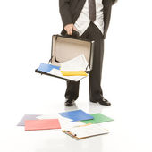 Businessman losing papers. — Stock Photo