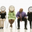 Stock Photo: Clocks over faces.