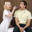 Stock Photo: Nurse giving patient pill.