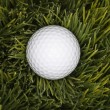 Golf ball in grass. — Stock Photo