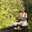 Asian woman meditating. — Stock Photo