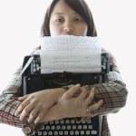 Woman holding typewriter. — Stock Photo