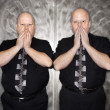 Twin men covering mouth. — Stock Photo #9531929
