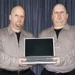 Twins with laptop. — Stock Photo