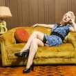 Woman on retro couch. - Stock Photo