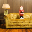 Santa figurine on couch. — Photo