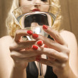 Royalty-Free Stock Photo: Woman holding  martini.