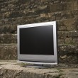 Television by brick wall. — Stock Photo