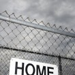 Home sign on fence. - Stock Photo