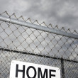 Home sign on fence. — Stock Photo