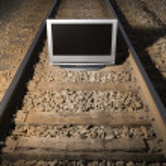 Television on train tracks. — Stock Photo