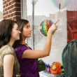 Stock Photo: Young Women Window Shopping