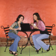 Stock Photo: Two Young Women Having Coffee