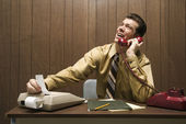 Businessman punching numbers. — Stock Photo