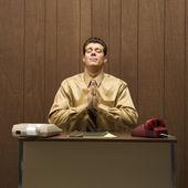 Praying businessman. — Stock Photo