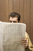 Businessman reading newspaper. — Stock Photo